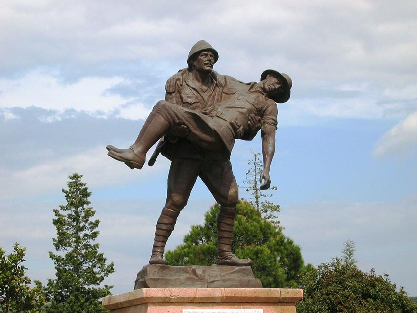 The statue of a turkish soldier carrying an anzac soldier